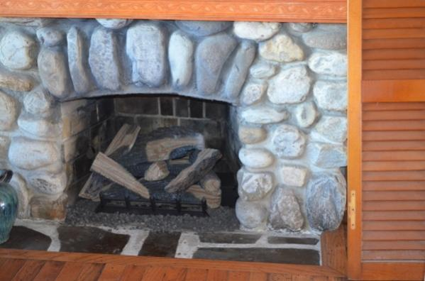 Some recent pics of my home-livingroom-fireplace-logs-replaced-600x397-.jpg